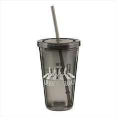 Made of BPA-free plastic, this travel-ready cup from The Beatles boasts the famous Abbey Road logo peering through the interior. The Beatles Abbey Road 18 oz. Acrylic Travel Cup is perfect for your favorite drink of choice any time of the day. Cool Travel Mugs, Travel Cup, Beatles Gifts, The Beatles Help, Greatest Rock Bands, Cup With Straw, Abbey Road, Yellow Submarine, Cleaning Wipes