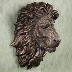 This would be nice on a garden wall or on a veranda. Power and Presence Lion Head Wall Sculpture