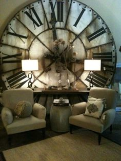 Giant antique clocks are all you need in a small space. It draws so much attention to the wall and opens up the space. Furniture with legs also helps with the illusion!
