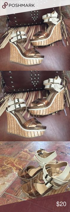 Gold Bronzed wedge heels Summertime wedge heels. 2 buckle straps around the ankles. Bronze color. New without the tags perfect condition. 3 inch feel very comfortable easy to walk in. Basket weave to wedge. Size 6. Perfect new condition Mossimo Supply Co Shoes Wedges