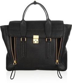 3.1 Phillip Lim The Pashli large shark-effect leather trapeze bag, 3.1 Phillip Lim's 'Pashli' trapeze bag is the ultimate everyday tote. Crafted from sturdy leather, this spacious design will easily hold all your daily essentials. Work it cross-body with the detachable shoulder strap.