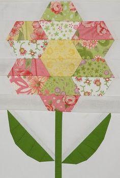 a hexagon flower quilt design, very pretty