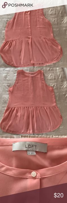 Loft sleeveless light pink/peach blouse Loft sleeveless blouse fits light and airy. Pairs really well with skinny jeans. Color is pinkish peach. LOFT Tops
