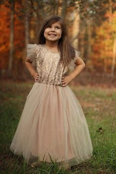 This blush champagne tulle and sequin dress is so elegant. The dress is fully lined. The fullness of this dress makes it perfect for fairy-tale weddings