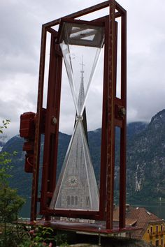 Clock Hourglass time:  A Salt-#Clock in front of a church tower in Hallstatt.