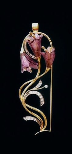 Pendant bells – female jewelry from yellow and white gold with diamonds and amethysts in the Art Nouveau style.