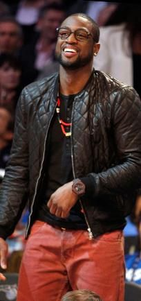 NBA Player Dwayne Wade.  I'm a bit iffy on the quilted leather jacket, but love the black on red combo, right down to the perfect accessories.  This works well!