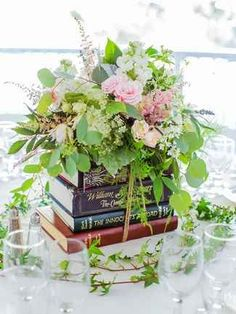 Creative Ways to Use Books as Wedding Décor Embrace your inner bookworm with these 14 creative ways to use books as wedding decor.Embrace your inner bookworm with these 14 creative ways to use books as wedding decor. Book Wedding Centerpieces, Unique Centerpieces, Wedding Flower Arrangements, Wedding Decorations, Centerpiece Flowers, Centerpiece Ideas, Floral Arrangements, Graduation Table Centerpieces, Book Decorations