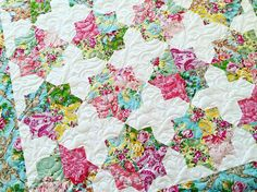 """Quilted this beauty earlier today! These florals have me wishing for Spring.  #quilting #longarmquilting"""