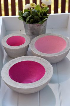 DIY concrete decorative/ornamental bowls crafted, hand-made and painted pink on the inside.