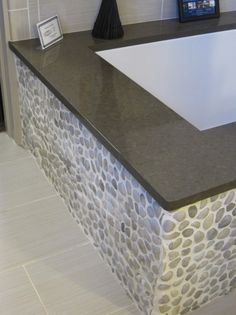love the pebbles and the dark tile/granite top and my floor tiles are grey like these too....