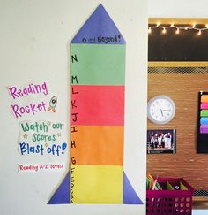 Tracker used to display student reading levels! Place a sticky note with student initials next to their reading level, and when they advance a level move their sticky note up.