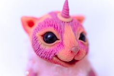 Fantasy animal. Unicorn and the cat at the same time)) Gentle caramel baby!)) Collectible toy, designed for children. Approximately 3,9 inch (10 cm) in sitting position. - Completely handmade - Made from Faux Fur. - Glass eyes. - Solid parts are made of polymer clay. - Color - pastel,