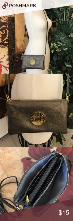 Cross-Body Bag Three compartments plus two credit card sections, cross-body bag with adjustable shoulder strap and gold tone metal design hardware. Excellent condition inside/out. Color: bronze/gold Bags Crossbody Bags