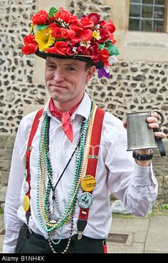 Morris dancer with floral hat and tankard of beer taking part in the Winchester Spring Festival in England Stock Photo