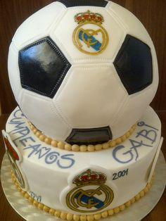 Real Madrid cake with history of their logo