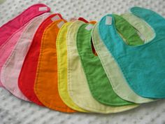 10 wholesale Boutique Handmade Flannel Rainbow Baby Bibs in Solid Colours. $25.00, via Etsy.