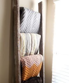 If you have a nice-sized collection of throws or blankets, organize them on a ladder. It will free up your couch (or bed) and add a touch of decor to the room. | HellaWella #organization #homeorganization #organizationtips