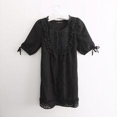 Black Dress with a Crochet Bib and Lace In good condition! This black dress has it all! No need for extra jewelry! There's a tie in the back to accentuate your waist. There are also non-adjustable ties on either arm. Dresses