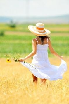 A white sundress and sunhat are in my closet waiting for me to wear this summer. #fashion
