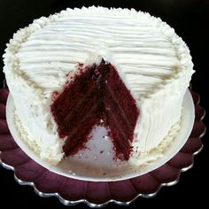 Red velvet cake filled with chocolate ganache and covered with cream cheese ribbons.