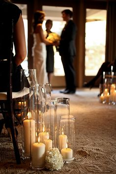 Totally in love with the candle lit wedding idea.