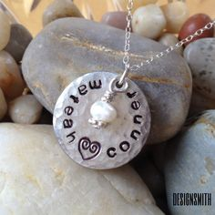 Perfect necklace for a mom or grandma. 3/4 inch handstamped name/heart pendant on sterling chain with drop bead of choice. May have multiple drop beads. By designsmith. $35