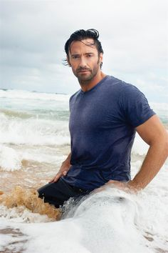 """Suddenly, a huge wave caught them both off guard.  It tumbled over the top of Erica then him.  He reached out for her in the water as the ocean threw him backwards.  Abruptly, he was back on the beach, spitting out water.  His head whipped back & forth looking for her.  Then he heard her laugh.  He looked down beside him.  There she lay, sprawled out on her stomach, her hair plastered to her face as she peeled it back.  He smiled at her.  """"Well, I'm glad YOU enjoyed that!"""""""