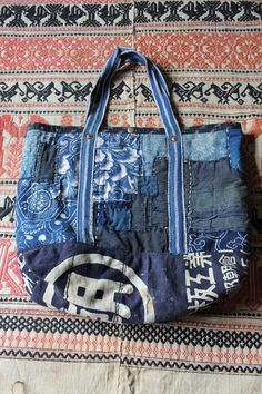 Boro tote bag , made of japanese indigodyed katazome cotton,vintage japanese kasuri and japanese noragi textile, with a lot of vintage japanese textiles. entirely hand sewn and hand knitted in cotton and linen twine. all hand stitching by me . but inside and upper, buttom is Handmade Clothes, Handmade Bags, Handmade Leather, Vintage Leather, Leather Purses, Leather Wallets, Leather Bags, Art Bag, Japanese Textiles