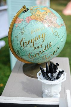 DIY Wedding Ideas for Brides Who Love Lettering | This globe is exactly what you need for the wedding with many out-of-town guests or the couple who loves to travel the world. Have your attendees mark where they've traveled from for the nuptials, use it for your guest book or to simply write out your new name as husband and wife.