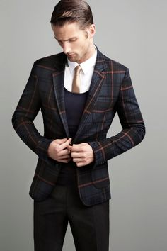 What a fantastic look...that plaid jacket, the low round neck sweater...gold metallic tie, ugh!!