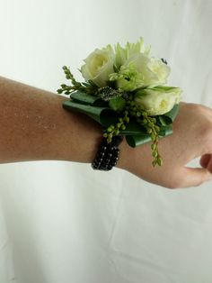 Ball corsage with greens and whites made on to a black beaded bracelet. Created by Florist ilene Flowers Delivered, Corsages, Gift Baskets, Beautiful Flowers, Bouquet, Beaded Bracelets, Green, Gifts, Wedding