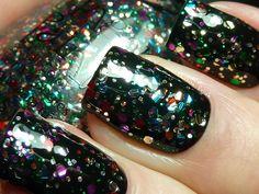 "Finger Paints ""Fun Fetti"" over black. Photo via Fashion Polish."