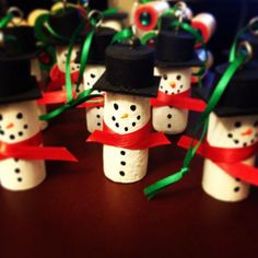 Snowman cork ornaments! Made using wine corks, craft paint, puffy paint, ribbon, wooden squares, and hot glue