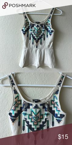 Express Sequined Tank This is a NWT Express Sequined Tank. Cream colored with blue, pink and green sequins in a tribal design. Sz XS Express Tops Tank Tops