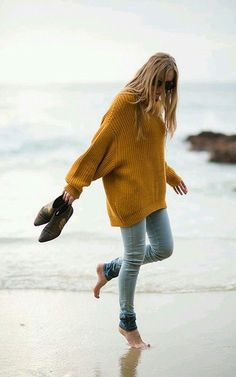 Oversized knit sweater with jeans.