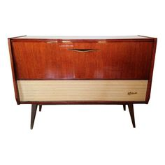 Mid Century Record Player + Tube Radio Console. What a cool piece to act as a tv stand, potentially.