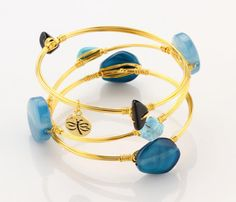 Handmade using tarnish resistant shiny gold plated wire and semi precious turquoise agate, crystal quartz and glass stones.