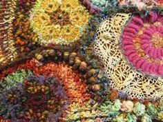 Crocheted. Neat way to use up bits of yarn laying around.