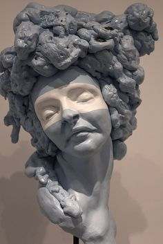 Ashley Maxwell figurative ceramic Sculpture. Strong use of texture in hair and also strong use of blue in sculpture but with white presence on eyes. Emotion of woman is bland and not expressive.