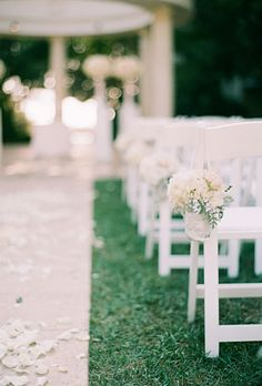 Brides.com: A Classic, Intimate Outdoor Wedding. Mason jars and buckets of white flowers dotted the Pacific Lawn of the St. Regis, the site of the wedding ceremony.