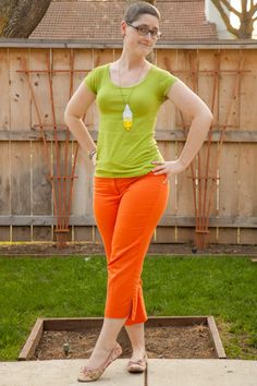 Green scoop-neck tee, orange capri pants, floral flats, DIY dip-dye yellow lace necklace.