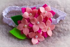 Pink and Fuchsia felt flower with pearl and leaf accent ruffle elastic headband on Etsy, $4.00 CAD