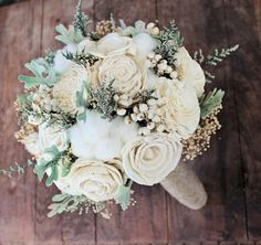 sola flowers, preserved casipa, preserved babies breath, faux dusty miller, tallow berries, and raw cotton with a rustic twine finish on the stem #bouquets @emmalinebride