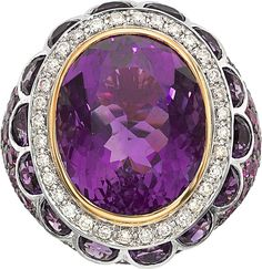 Amethyst, Pink Sapphire, Diamond, White Gold Ring, Zorab The ring features an oval-shaped amethyst measuring 18.80 x 15.40 x 10.95 mm and half-moon-shaped amethyst weighing a total of 20.56 carats, enhanced by round-cut pink sapphires weighing a total of 4.44 carats, accented by full-cut diamonds weighing a total of 0.45 carat, set in 18k white gold, marked Zorab. Gross weight 18.80 grams.