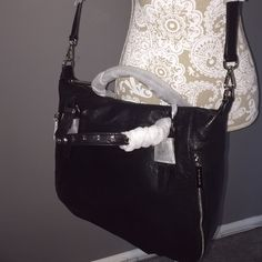 🌟🌟MAKE OFFER🌟🌟 MMK STUDDED LG ESSEX BAG! MMK STUDDED LG ESSEX BAG NWT BLACK. RETAIL $378 +tax. Studs are on the handles.   Silver hardware      ❌TRADES❌.  OPEN TO REASONABLE OFFERS. MICHAEL Michael Kors Bags