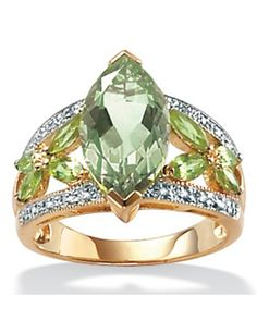Opulence shines from every angle of this ring lavished with marquise-cut green amethyst and peridot. A stunning selection offering 4.55 carats T.W. of gemstones highlighted with glistening diamond accents. Tutone. 18k gold over sterling silver. Sizes 5-10. catherines.com