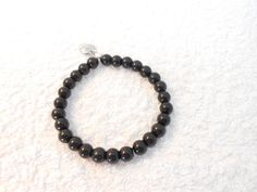 Black bracelet made with elastic cord great for bridesmaid