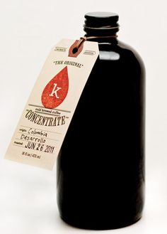 love the tag in contrast to the black bottle  #packaging #stamp #vintage