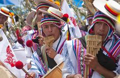 Playing the Andean flute for the Virgen de la Candelaria festival in Puno, Lake Titicaca